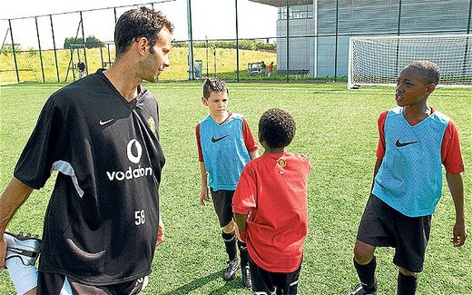 Waiting in the wings: Ryan Giggs with Danny Welbeck (far right) at 13