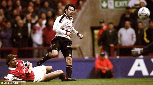Ryan Giggs avoids Tony Adams' tackle to score for United against Arsenal