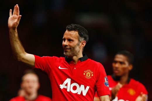 Giggs waves to the Old Trafford crowd after his last appearance for United