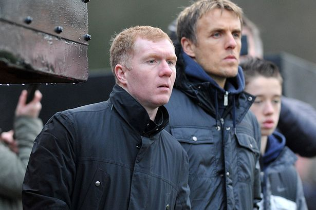 Paul Scholes and Phil Neville in the Salford City dug out during the season