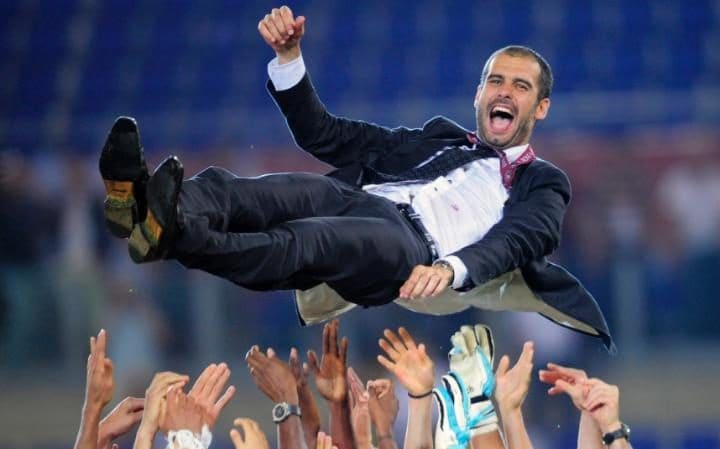 Pep Guardiola is thrown into the air by his Barcelona players after completing the last leg of a 2009 Treble at Ryan Giggs' expense. CREDIT: AP PHOTO/MANU FERNANDEZ.