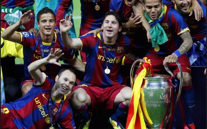 Barcelona pose with the trophy after winning their second Champions League in three years by defeating Manchester United. CREDIT: GETTY IMAGES.