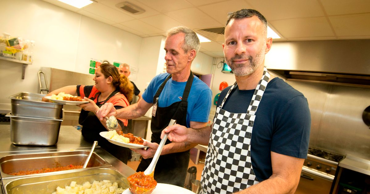 Ryan Giggs serves meals to homeless people at the Booth Centre