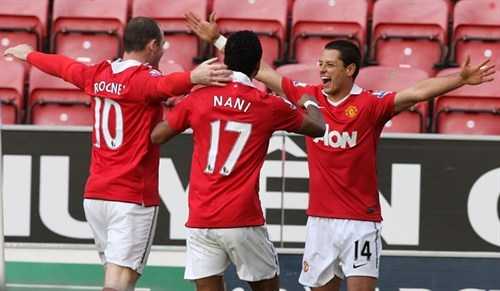 Chicharito celebrates his first goal at the DW Stadium with Rooney and Nani