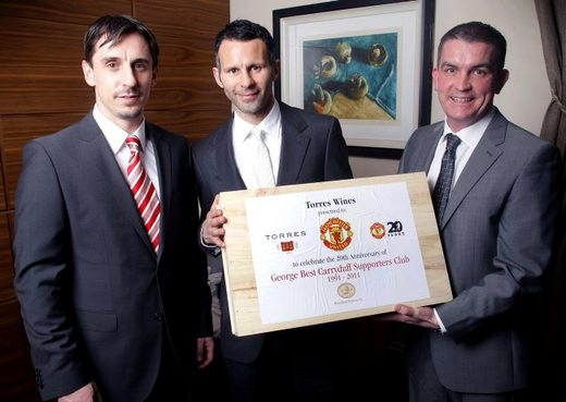 Gift sets are presented to Ryan Giggs and Gary Neville by Gareth Bradley, managi